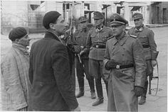 Maximilian von Herff inspecting progress of liquidation of Warsaw Ghetto