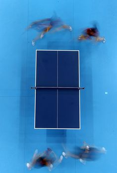 Erica Wu and Lily Zhang of the United States (top) in action against Kasumi Ishikawa and Ai Fukuhara of Japan in the first round of the Womens Team competition on Day 7 of the London 2012 Olympic Games at ExCeL on August 3, 2012 in London, England.  Photo by: Richard Heathcote/Getty Images
