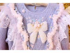 Detaisl of baby blue knit dress by Etsuna Otsuka