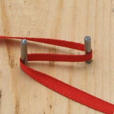 Ribbon loops made on a bow former by wrapping the ribbon around the tines in a figure eight. - Photo ©2008 Lesley Shepherd, Licensed to About.com Inc.