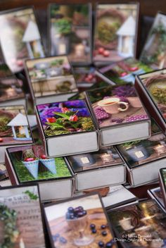 small photos placed on match box, bundle several together with a ribbon for a nice gift