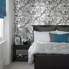 White pintuck quilt in blue and brown bedroom