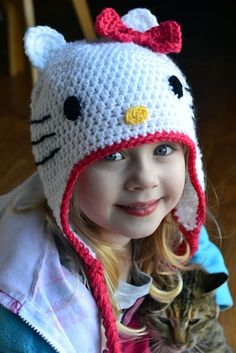 Free Hello Kitty hat pattern!    change up a few things:  - make the ears more triangular  - single crochet the whiskers (either directly by ava