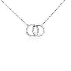 Inspiring in design, this infinity rings necklace is fashioned with two petite, hollow sterling silver rings linked together to form this simply classic piece.