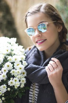 reflective sunglasses and lovely flowers, braided hair and a black and white striped shirt for fall