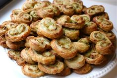 Pesto Parmesan Palmiers by wittyinthecity: Savory overload! They are relatively simple to make if you use store-bought puff pastry, and you can make endless varieties depending on what you put in them. #Appetizer #Palmiers