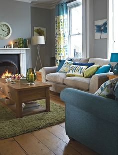 greens, blues with grey walls and wood like curtain fabric in this room