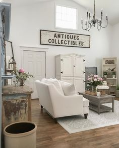 White guest cottage great room, casual living room decor with vintage touches and fresh Summer peonies.