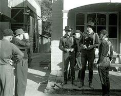 """John Ford (L) sets up a scene for """"The Horse Soldiers"""" in front of the Newton Station bar with William Holden, Willis Bouchey, John Wayne and unknown (William Wellman Jr. Old Hollywood Movies, Golden Age Of Hollywood, John Wayne Movies, Maureen O'hara, John Ford, Actor John, Western Movies, 1 John"""