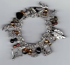 Hunger Games loaded charm bracelet from patty_o_furniture on craftster.org