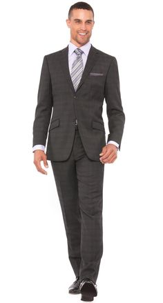 <p><span><strong><span>The Melange Parc 81 men's slim fit suit by Bachrach exhibits a classic textured plaid designed for the modern man. Styling includes a 2 button narrower notch lapel jacket with double vents and flat front pants. Fashioned from 100% pure wool suiting.</span></strong></span></p> $498.00