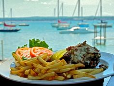Apache Trout Grill Best Whitefish/Seafood and great view.  Try the Panko Crusted Whitefish or the Pan-fried Walleye with pecan buerre blanc.  Nice to dine outside on the expansive lakeside patio. Best place you can BOAT to.