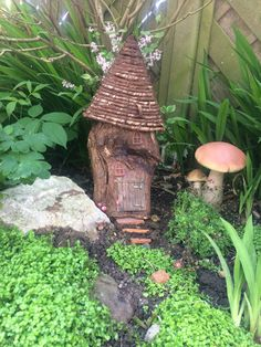 Fairy house made out of a log and an old hanging basket!