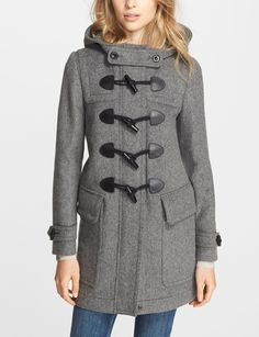 Obsessed with the chunky toggles on this Burberry wool duffle coat.