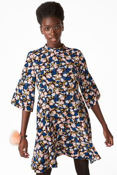 Make a statement with this lovely oversized printed dress.