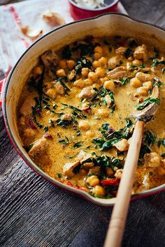 Green Chickpea & Chicken Curry with Swiss Chard Serves: 6 A rich coconut based curry made with chicken, chickpeas and Swiss chard. Ingredients 2 tablespoons olive oil 6 chicken thighs, cut into bite-sized pieces 2 shallots, thinly sliced 3 tablespoons green curry paste 2 tablespoons chili paste 1 teaspoon kosher salt ½ teaspoon ground ginger 1 14-ounce can coconut milk 2 cups water 1 14-ounce can chickpeas, rinsed and drained 1 bunch Swiss chard