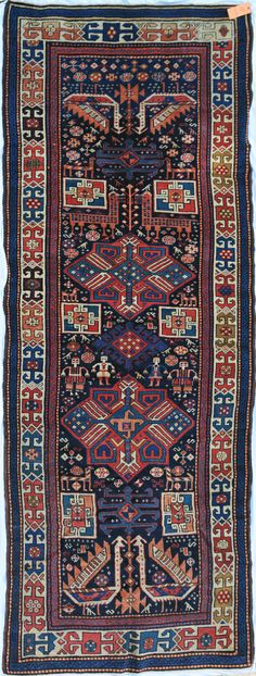AKSTAFA LONG RUG, EAST CAUCASUS, approximately 9ft. 1in. by 3ft. 5in. (2.77 by 1.04m.) late 19th century. Sold at Sotheby's Dec 16, 2004 for $4200.