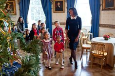 First Lady Michelle Obama brings Military Kids through the White House at Christmas