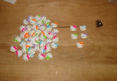 hello kitty's and lots of them Beading Supplies, Beadwork, Hello Kitty, Triangle, Beads, Beading, Pearl Embroidery, Bead, Pearls