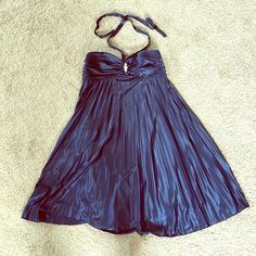 Semi formal Navy Blue Dress Super elegant and classic dress! Perfect for a homecoming dance, semi formal, cocktail party, or wedding. Halter dress that is pleated at the bottom. Pretty shiny broach at breast. Cups are thick and lined. Dresses Wedding