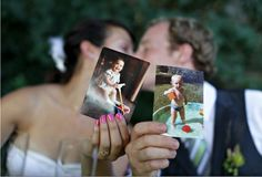 Cute wedding photo idea- pose with their baby picture