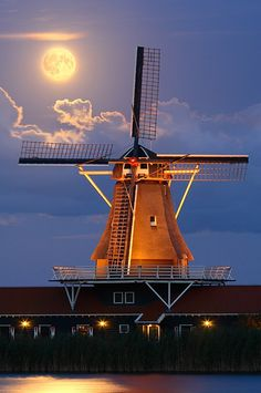 Moon over windmill in Holland.