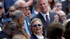 "moments before she felt ""unwell"" - fainted... health issues remain a big question... we can expect more lies about them and everything else it would seem... US Democratic presidential candidate Hillary Clinton and New York Mayor Bill de Blasio (R) attend ceremonies to mark the 15th anniversary of the September 11 attacks at the National 9/11 Memorial in New York, New York, 11 September"