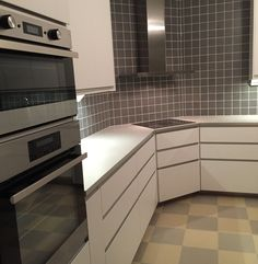 We did IKEA Nodsta, Perstorps virrvarr countertop, grey tiles.. The appliances are also IKEA (Electrolux).. Floor is Forbo marmoleum click, so soft you can sit on the floor!
