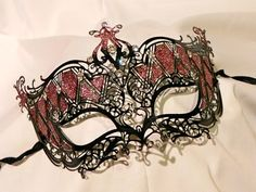 Black and Red Metallic Masquerade Mask by thecraftychemist07, $65.00. Pretty hand made mask. Artist also takes special requests.