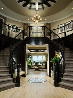 Toll Brothers An elegant dual circular staircase at the foyer greets family and friends. Can I please have this in my future house? Double Staircase, Grand Staircase, Black Staircase, Home Goods Decor, Home Decor, Foyer Decorating, House Goals, My Dream Home, Future House