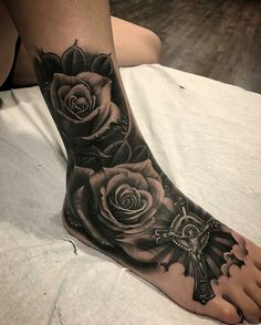 Love the placement and the look of the roses in this tattoo! Cute Tattoos On Wrist, Leg Tattoo Men, Foot Tattoos, Tattoos For Guys, Sleeve Tattoos, Tattoos For Women, Tattoo Na Barriga, Headdress Tattoo, Gangster Tattoos
