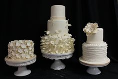 Trio of wedding cakes ivory flowers by Amanda Oakleaf Cakes, via Flickr