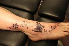 Pretty butterfly foot tat