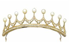 A PEARL AND DIAMOND TIARA, BY JEAN LOMBARD   Designed as nine undulating old-cut diamond crests with pearl finials, mounted in gold, made in 1960  Signed Lombard