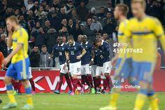Raphael Varane of France celebrates scoring a...