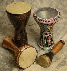 This drum is the king of all Arabic drums. Doumbeks are made out of ceramic or metal. Traditional drums have a goatskin head. The drum can be played upright between your legs or laying horizontally across your left thigh.