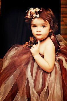 This is a picture of my niece on my wedding day. I hand made the dress and bow. :) astrammel