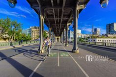 Easy Ride - Pont de Bir-Hakeim, Paris, France. Image by David Gutierrez Photography, London Photographer. London photographer specialising in architectural, real estate, property and interior photography. http://www.davidgutierrez.co.uk #realestate #property #commercial #architecture #London #Photography #Photographer #Art #UK #City #Urban #Beautiful #Interior #Arts #Cityscape #Travel #Building #Structure #Paris #France #Design #Bridge #Bicycle