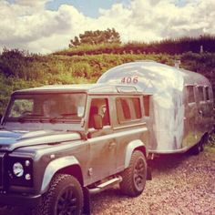 Airstream being pulled by a Land Rover Defender 90