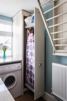 Slide out ironing board and top down, drying rack.  Laundry room ideas.