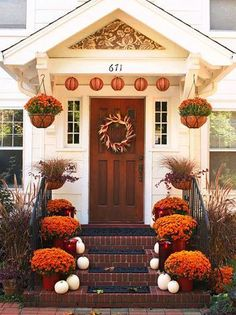 Fall front porch... Loving the white pumpkins and orange mums