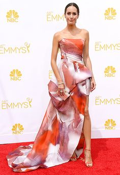 Louise Roe: 2014 Emmys The fashionista wore a watercolor floral gown and coral shoes by Monique Lhuillier and carried an Edie Parker clutch.