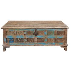 An artful addition to your living room or den, this reclaimed wood coffee table features a lift top and warmly weathered finish.