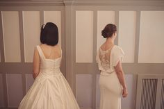 Two beautiful brides one wears a 1930s backless lace gown and the other wears a tea length 1950s gown | Photography by http://www.rebeccadouglas.co.uk/blog/