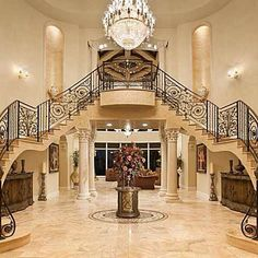 Grand foyer with custom wrought iron double staircase.