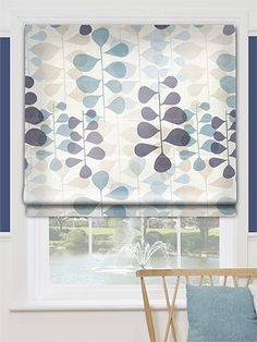 Our Blooming Meadow Blue roman blind has a soothing collection of colours on a restful faux silk fabric, working together to capture the comfort of such a room and amplify it.