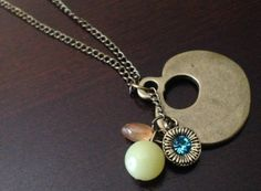 Large brass pendent with beads & charm necklace.  By Renewed Root.