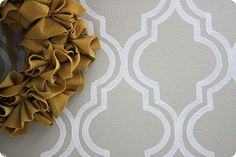 DIY wall stencil. I'm thinking about doing this in the inset behind the couch in our new place :)
