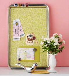Magnetic Memo Board and Tacks    A cookie sheet or jelly roll pan, minus the dough, doubles as a magnetic message holder. Measure your pan and cut scrapbook paper or wallpaper to fit. Use a corner rounder to round each corner of the paper. Secure the paper to the pan using double-stick tape. Back flat florist's stones with colorful images, and glue on magnets to hold your messages in place.