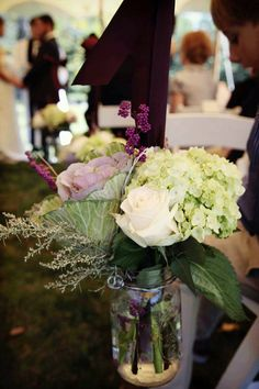 mason jar centerpiece with hydrangeass, cabbage, roses